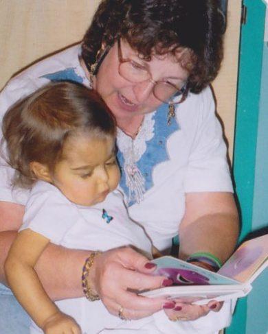Marilynn Zeljeznjak reading to her granddaughter, Sarah.