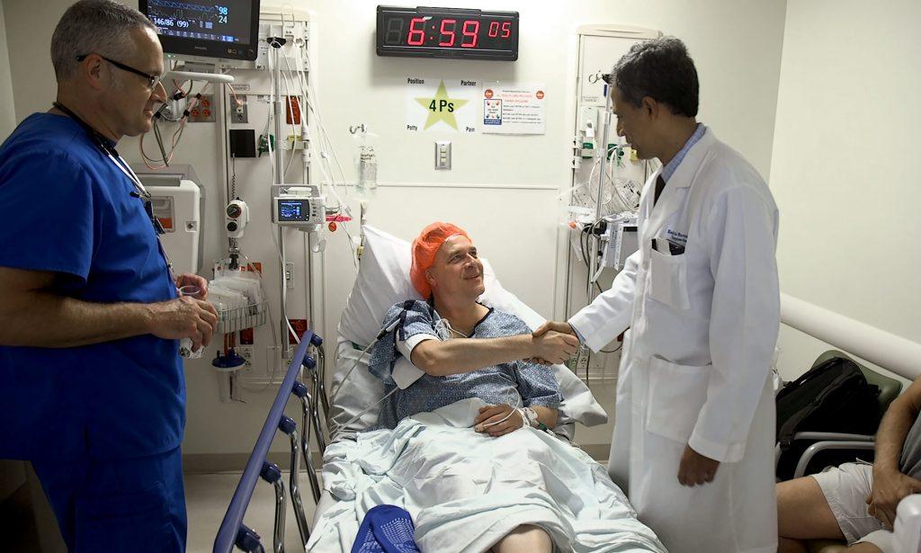 Karl Neumann meets Dr. Kadiyala Ravindra in pre-op before donating a kidney. Photo Courtesy: Shawn Rocco/Duke Health