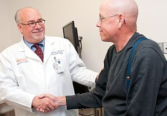 Dr. Kenneth Brayman with a patient. Courtesy of UVA Health System.